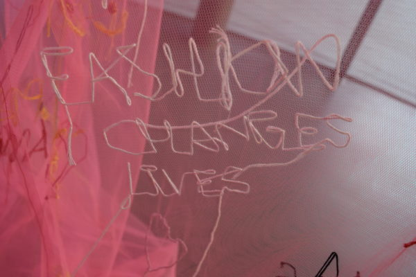 """Fashion Changes Lives"" sewn in by a embroider"